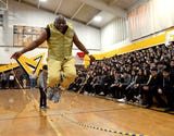 The class of 1968 graduate who's gone on to star in movies, compete in Olympic trials and perform across the country came home for a special assembly.