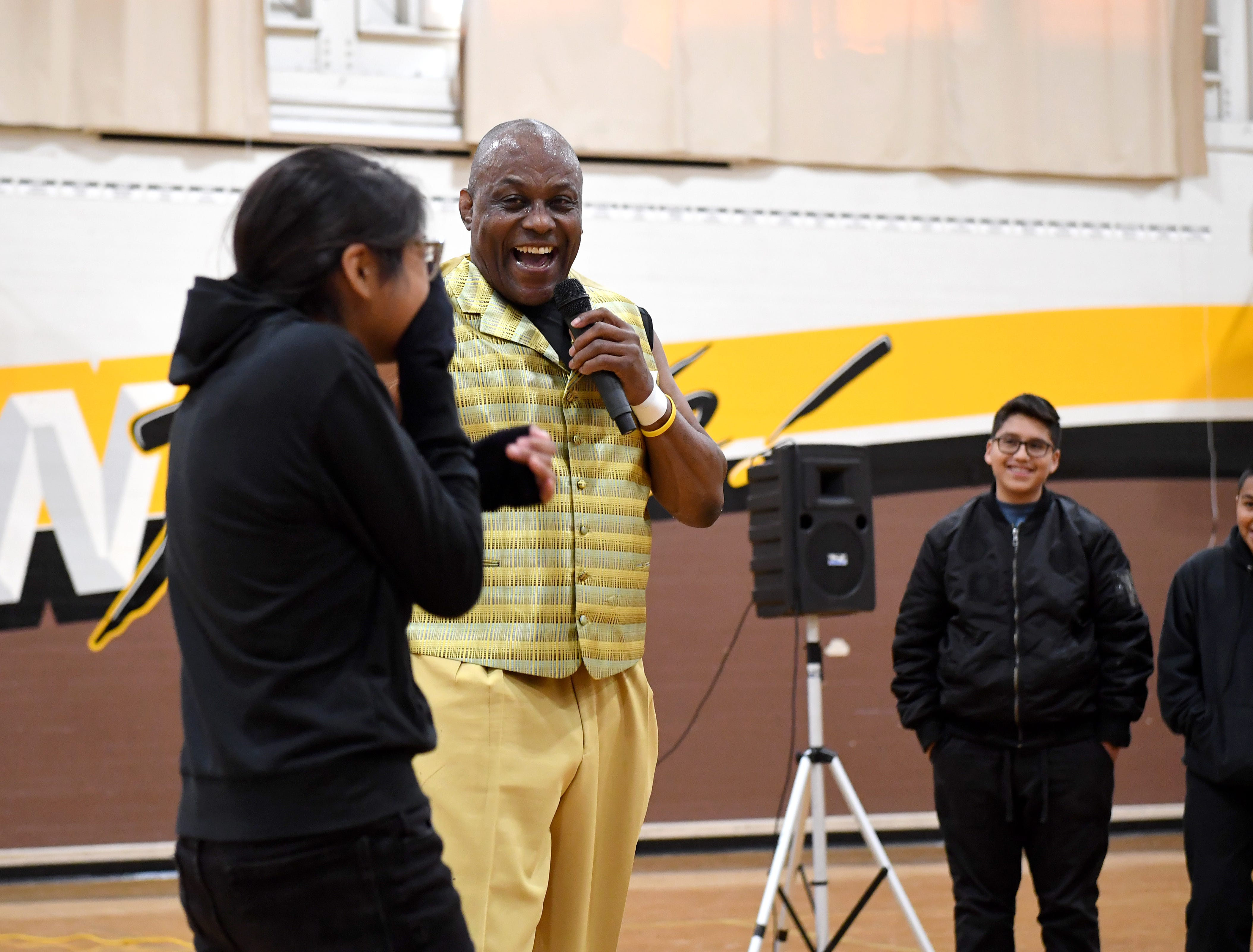 James Thompson jokes around with a student at El Sausal Middle School during a visit on Feb. 21, 2019.