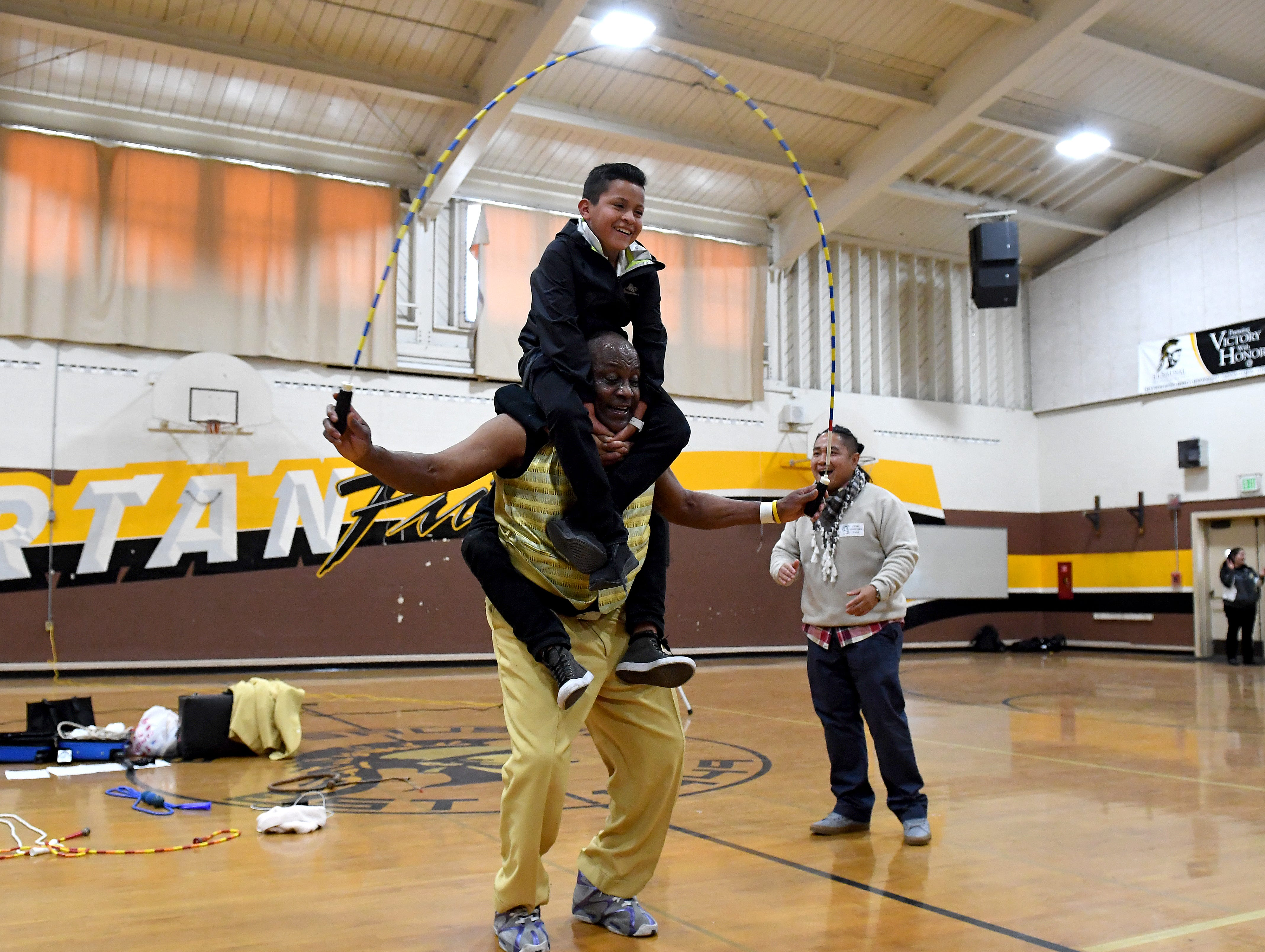 James Thompson performs with a student from El Sausal Middle School on his shoulders during a visit to his alma mater Feb. 21, 2019.