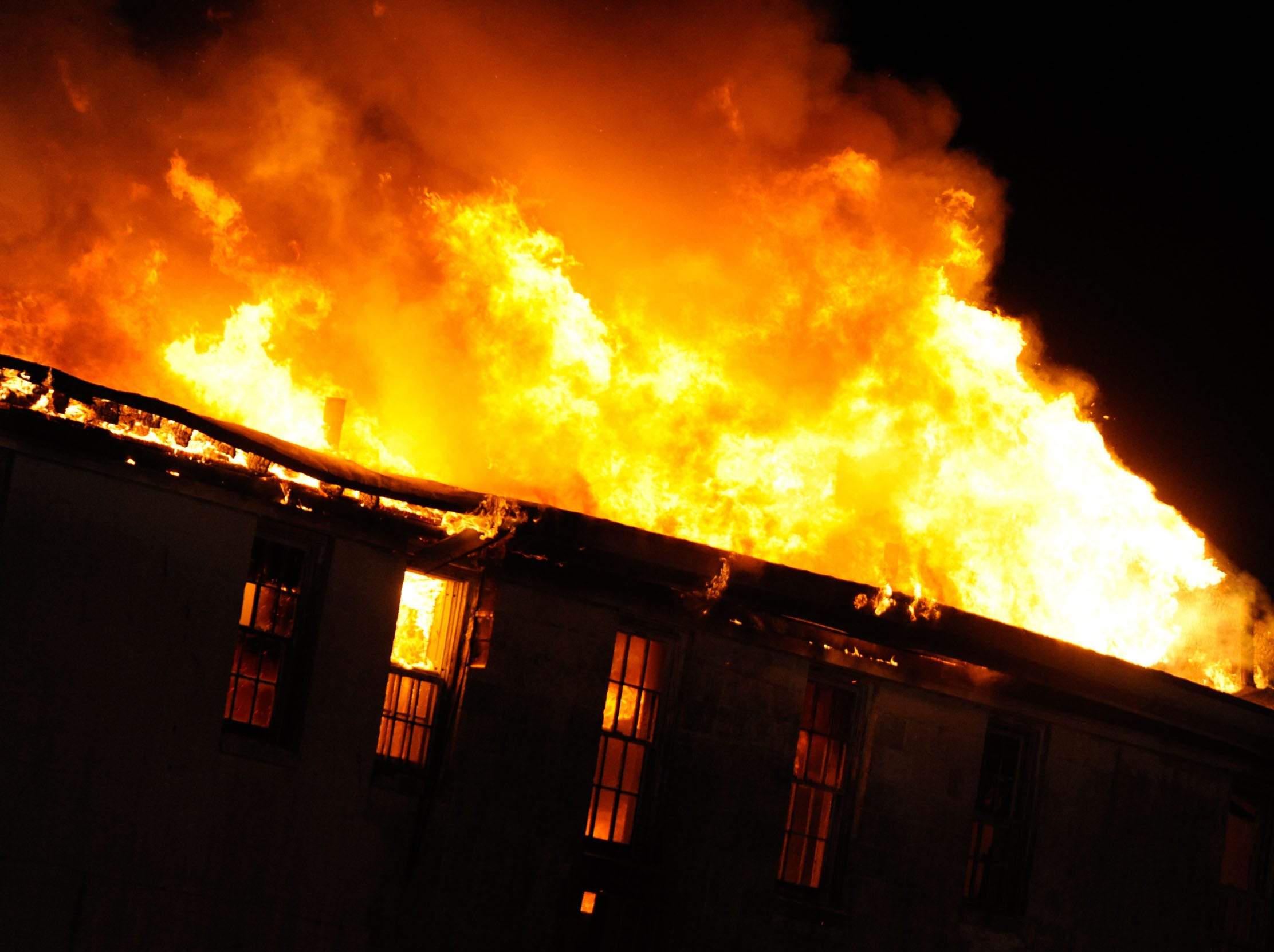 The Whispering Pines Motel in Tasley, Va. burns on Tuesday, March 12, 2013. Investigators believe the fire to be the work of an arsonist in Accomack County who has set more that 65 fires since November. The motel is the largest fire set so far. Parts of the motel date to the 1930s.