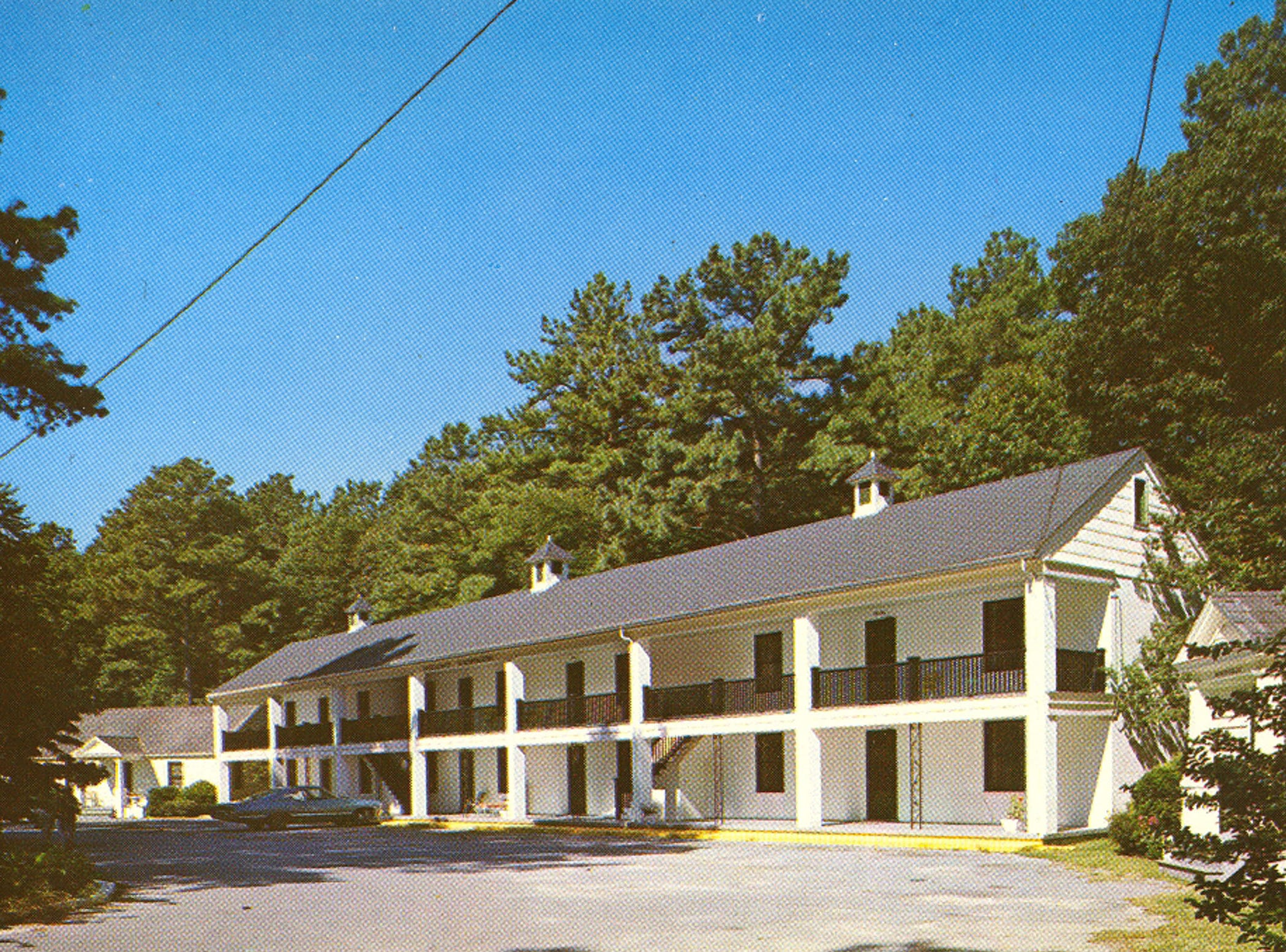 A 1960s postcard of the former Whispering Pines Motel in Tasley. The tourist destination, which has been mostly vacant for over a decade, was set on fire Tuesday, March 12, 2013. Investigators believe the fire to be the work of an arsonist in Accomack County who has set more than 65 fires since November.
