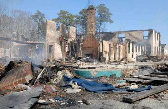 Remains of the Whispering Pines Motel on Wednesday, March 13, 2013 after fire swept through the famous Tasley structure the night before. Police are investigating the fire as an arson.