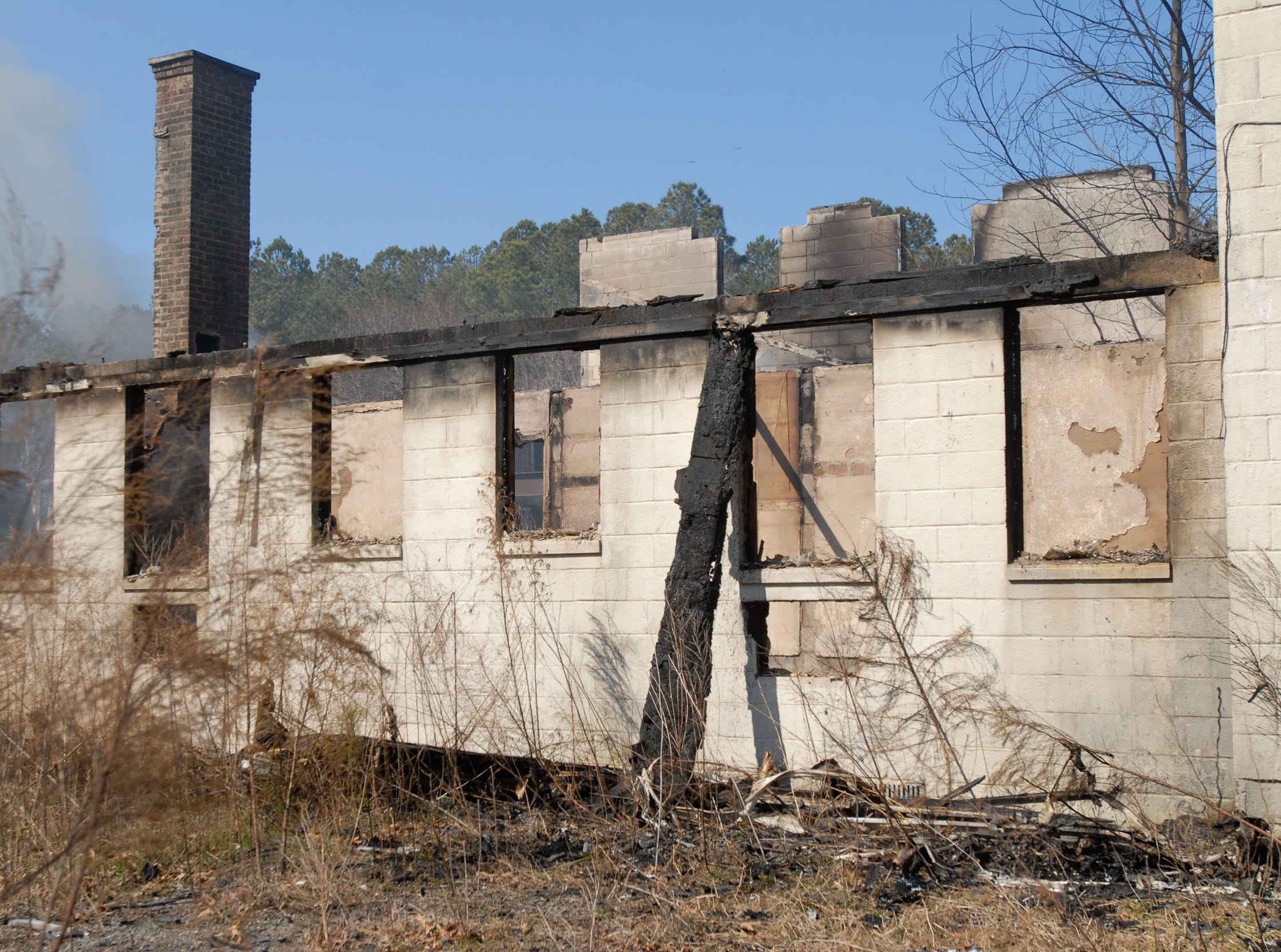 The remains of the Whispering Pines Motel are seen on wednesday, March 13, 2013 after fire swept through the famous Tasley structure the night before.