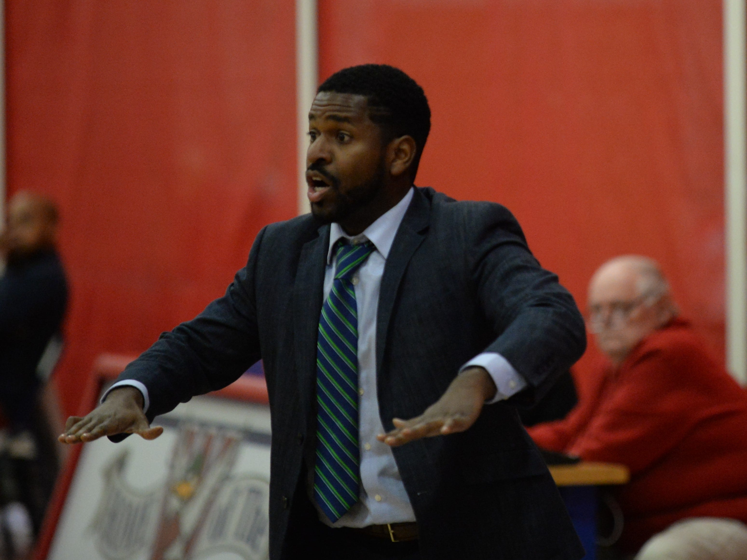 Delmarva Christian coach Jedidiah Roach signals to his team during the ESIAC Championship game on Thursday, Feb. 21, 2019. Delmarva Christian won the contest, 37-28.