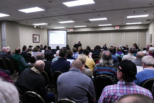 Over 100 residents and professionals listen as the Wicomico County Health Department and the Maryland Department for the Environment lay out a plan to improve septic system permits at a meeting at the Wicomico Youth & Civic Center on Thursday, Feb. 21, 2019.