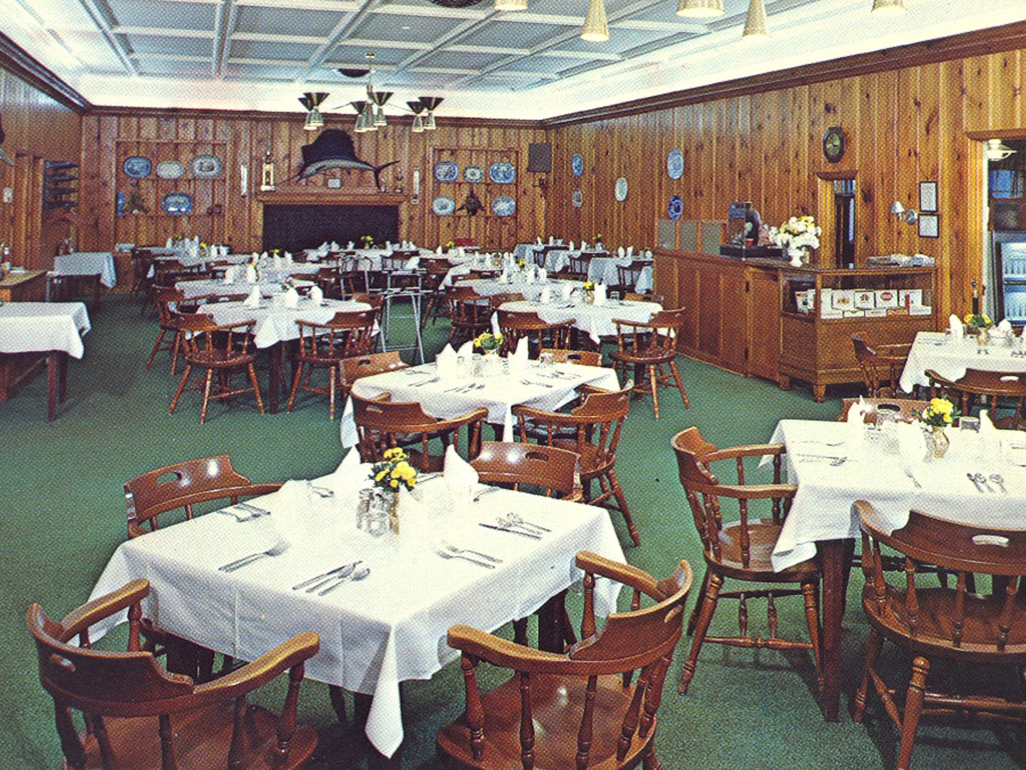 A 1960s photo of the dining room of the former Whispering Pines Motel in Tasley. The tourist-destination, which has been mostly vacant for over a decade, was set on fire Tuesday, March 12, 2013. Investigators believe the fire to be the work of an arsonist in Accomack County who has set more than 65 fires since November.