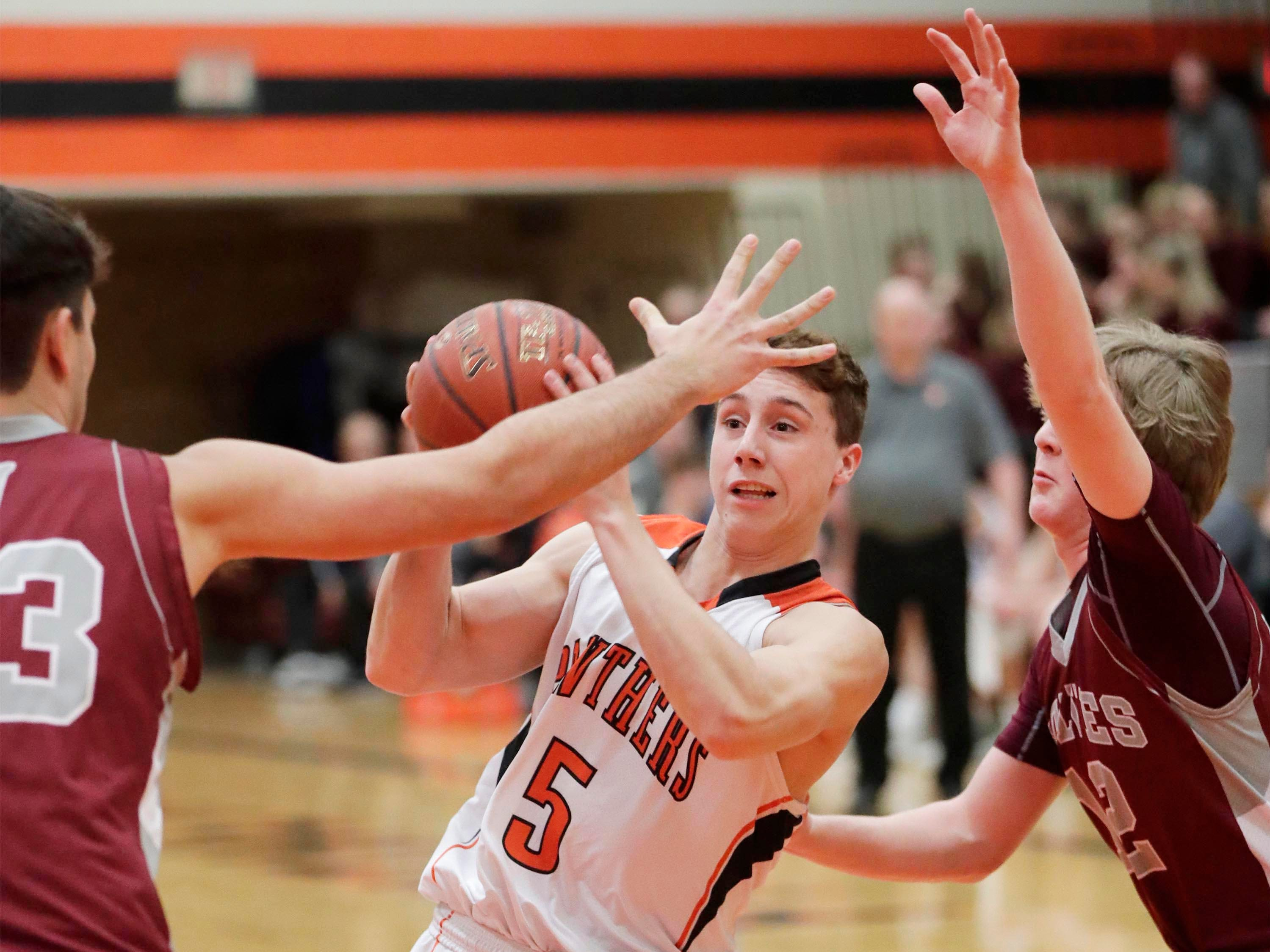 Plymouth's Sam Shutter (5) looks to pass the ball against Winneconne, Wednesday, February 21, 2019, in Plymouth, Wis.
