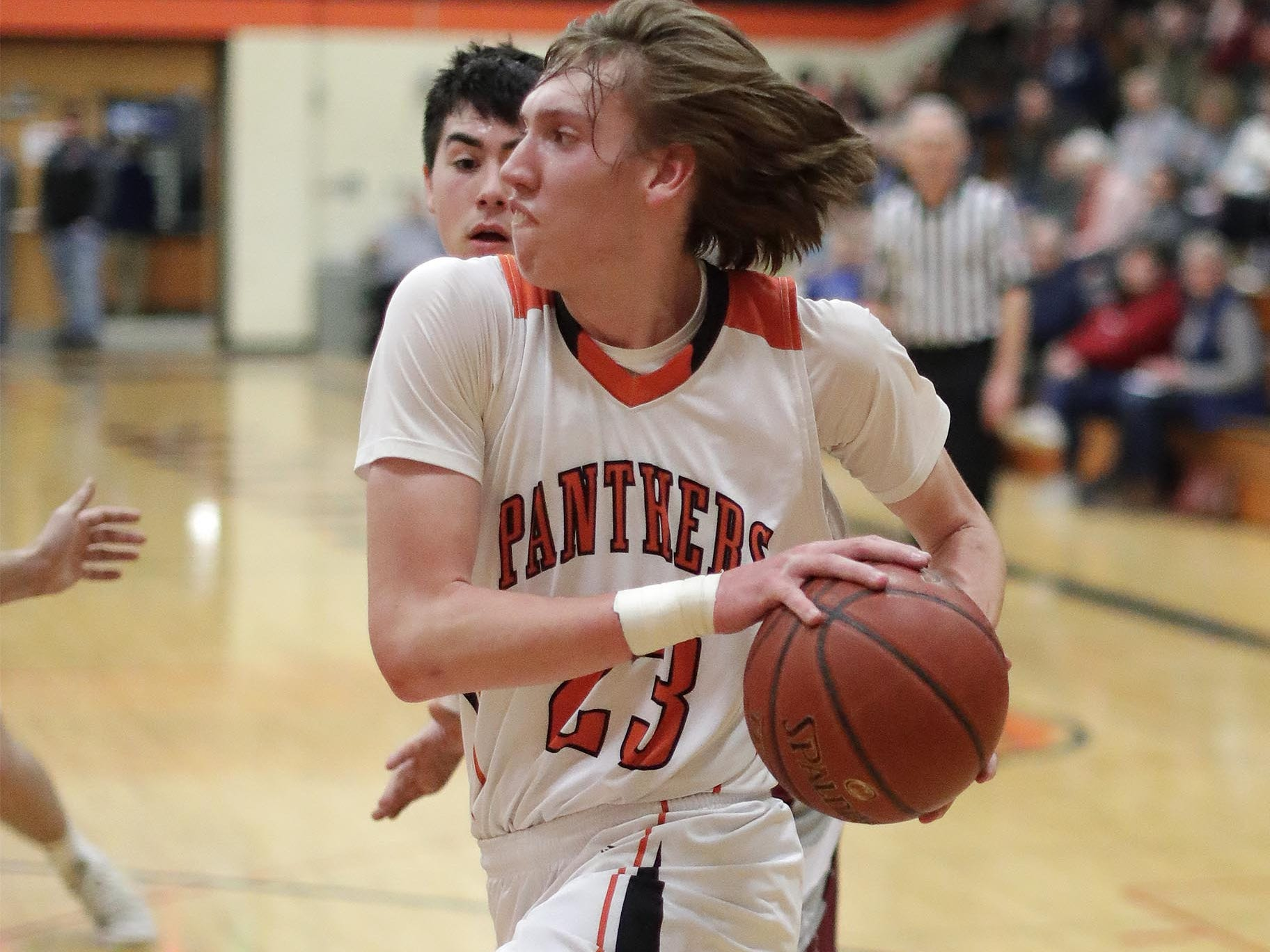Plymouth's Zach Zeeveld (23) drives the ball against Winneconne, Wednesday, February 21, 2019, in Plymouth, Wis.