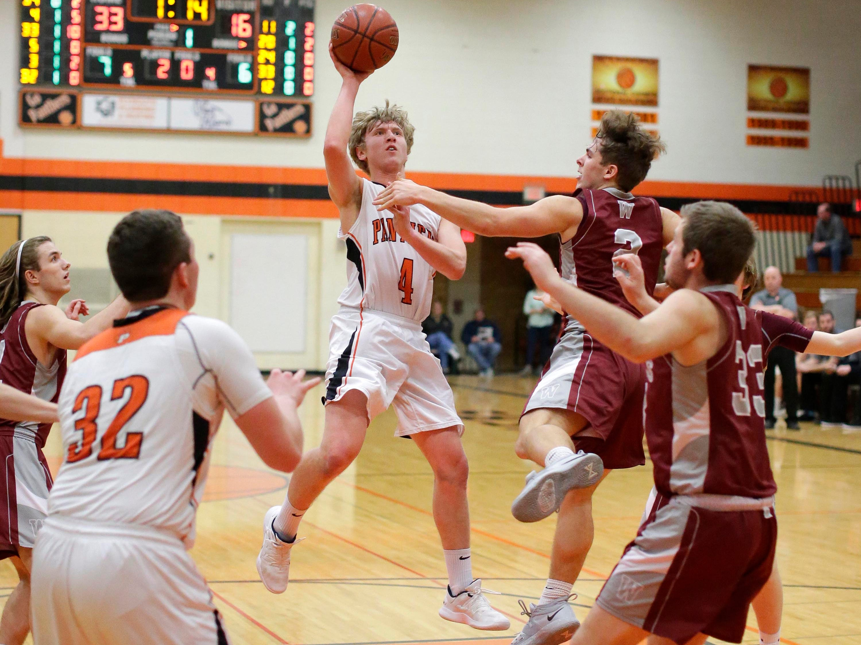 Plymouth's Joe Steinhardt (4) aims for the basket against Winneconne, Wednesday, February 21, 2019, in Plymouth, Wis.