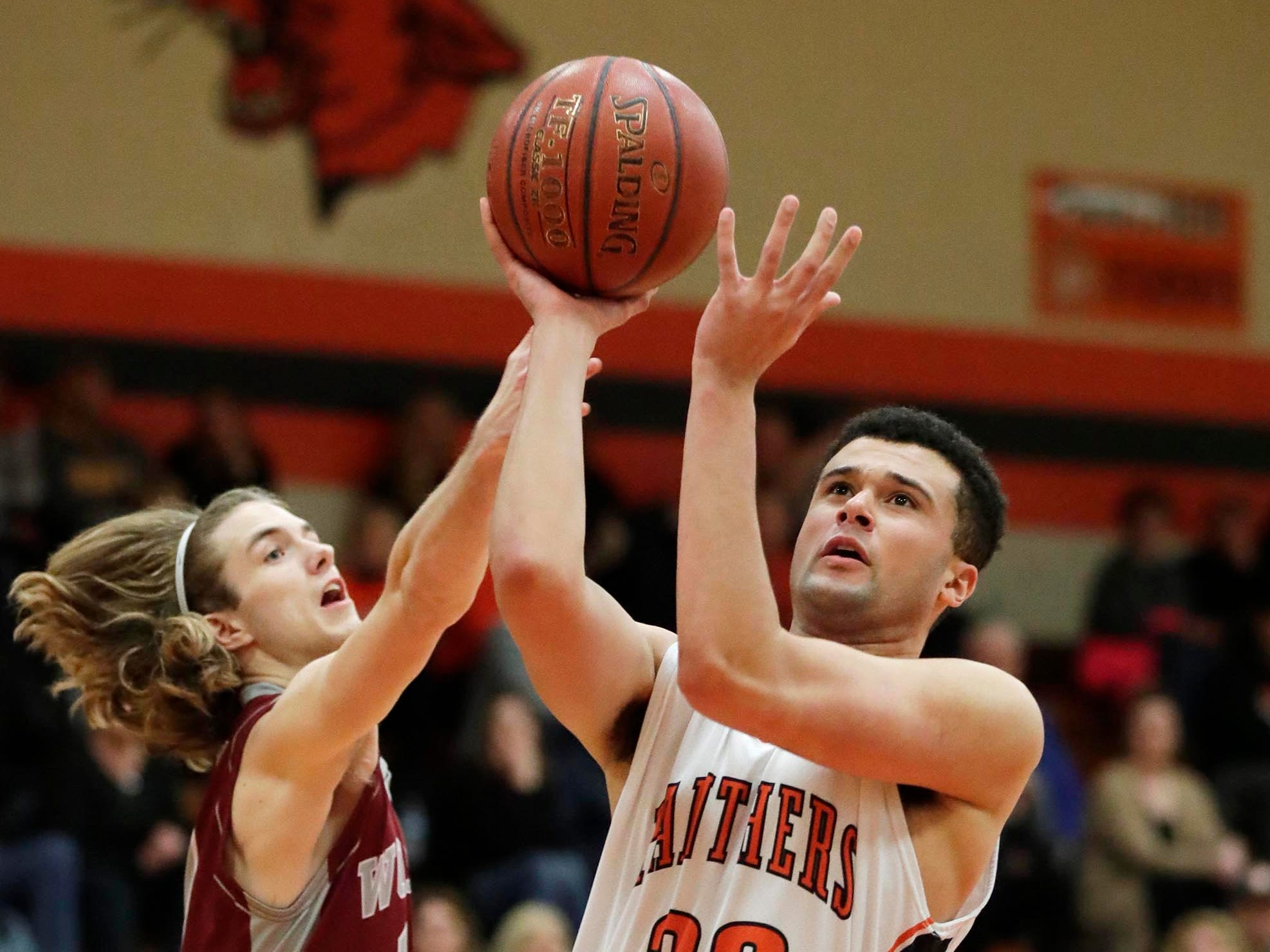 Plymouth's Nick Falls (33) drives to the hoop against Winneconne, Wednesday, February 21, 2019, in Plymouth, Wis.