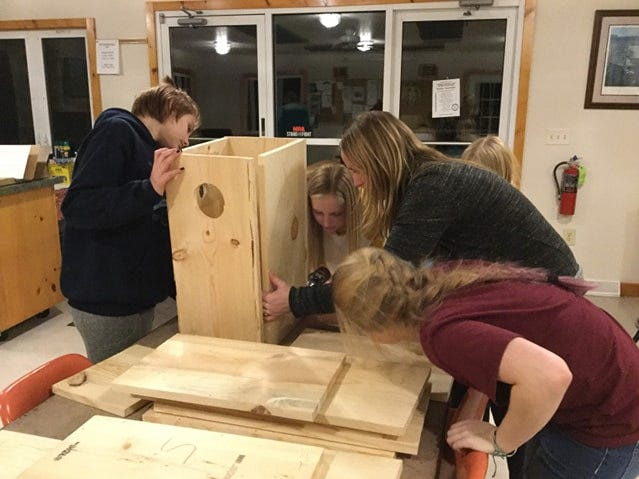 Hermitage Conservation Club and kids from the local 4-H organization teamed up to build new duck houses.
