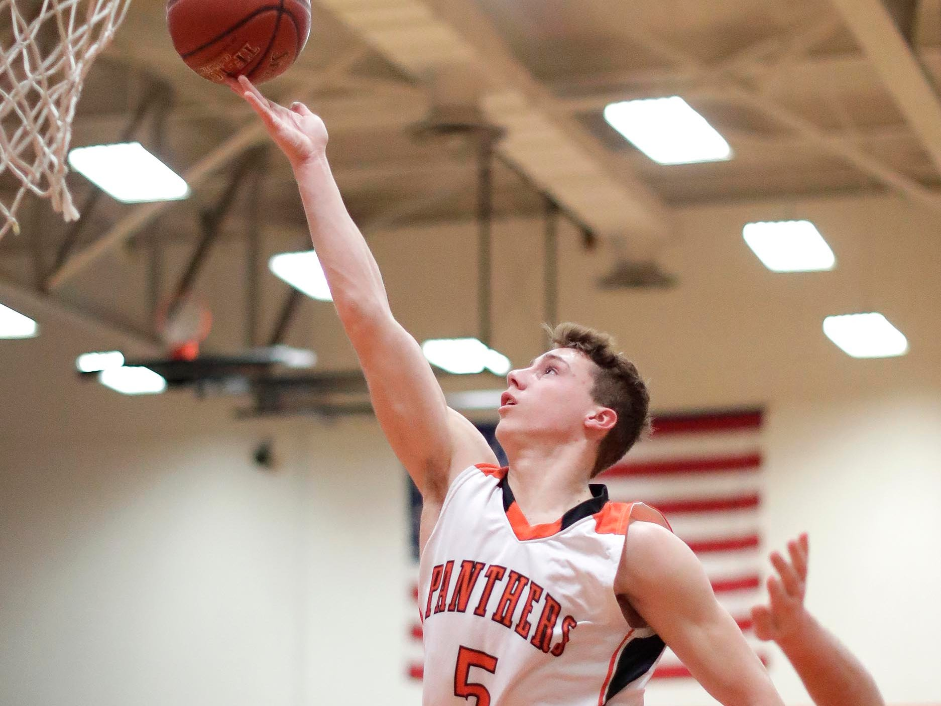 Plymouth's Sam Shutter (5) aims for the basket against Winneconne, Wednesday, February 21, 2019, in Plymouth, Wis.