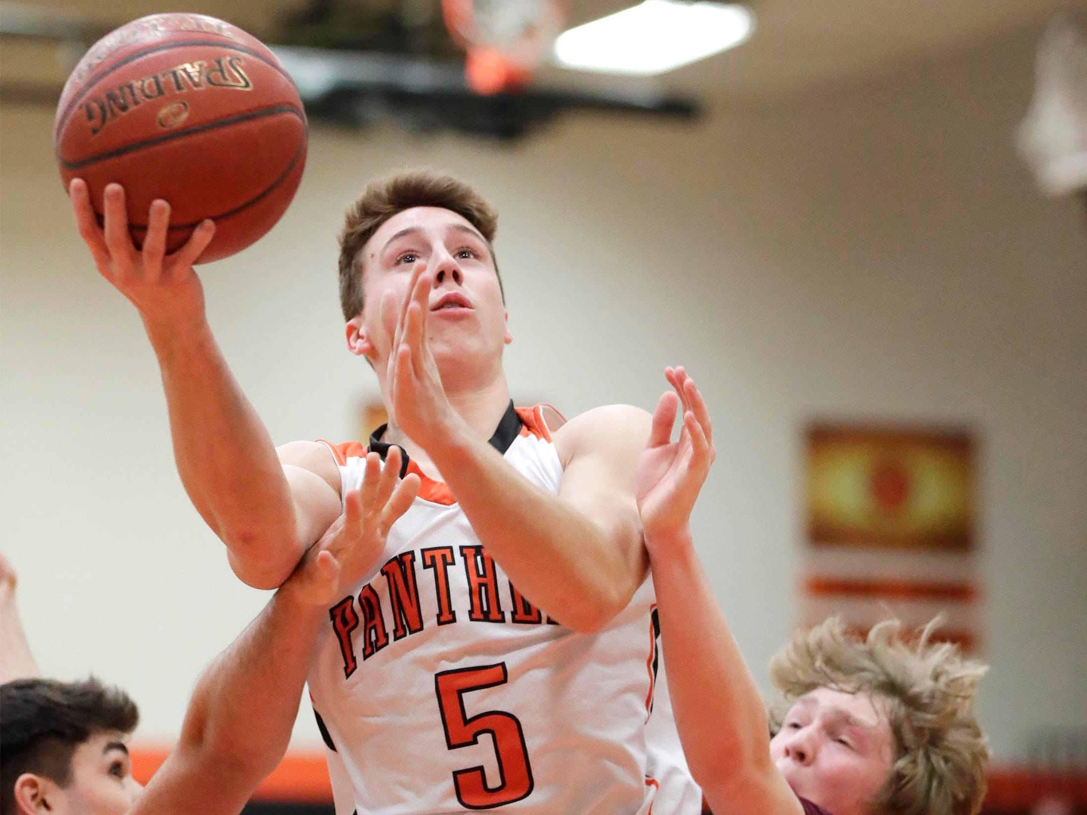 Plymouth's Sam Shutter (5) launches the ball against Winneconne, Wednesday, February 21, 2019, in Plymouth, Wis.