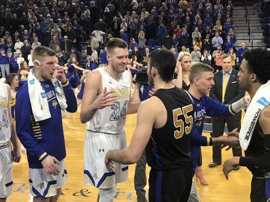 SDSU's Mike Daum and PFW's John Konchar exchange a postgame embrace after the Jacks' 92-83 win Thursday night at Frost Arena