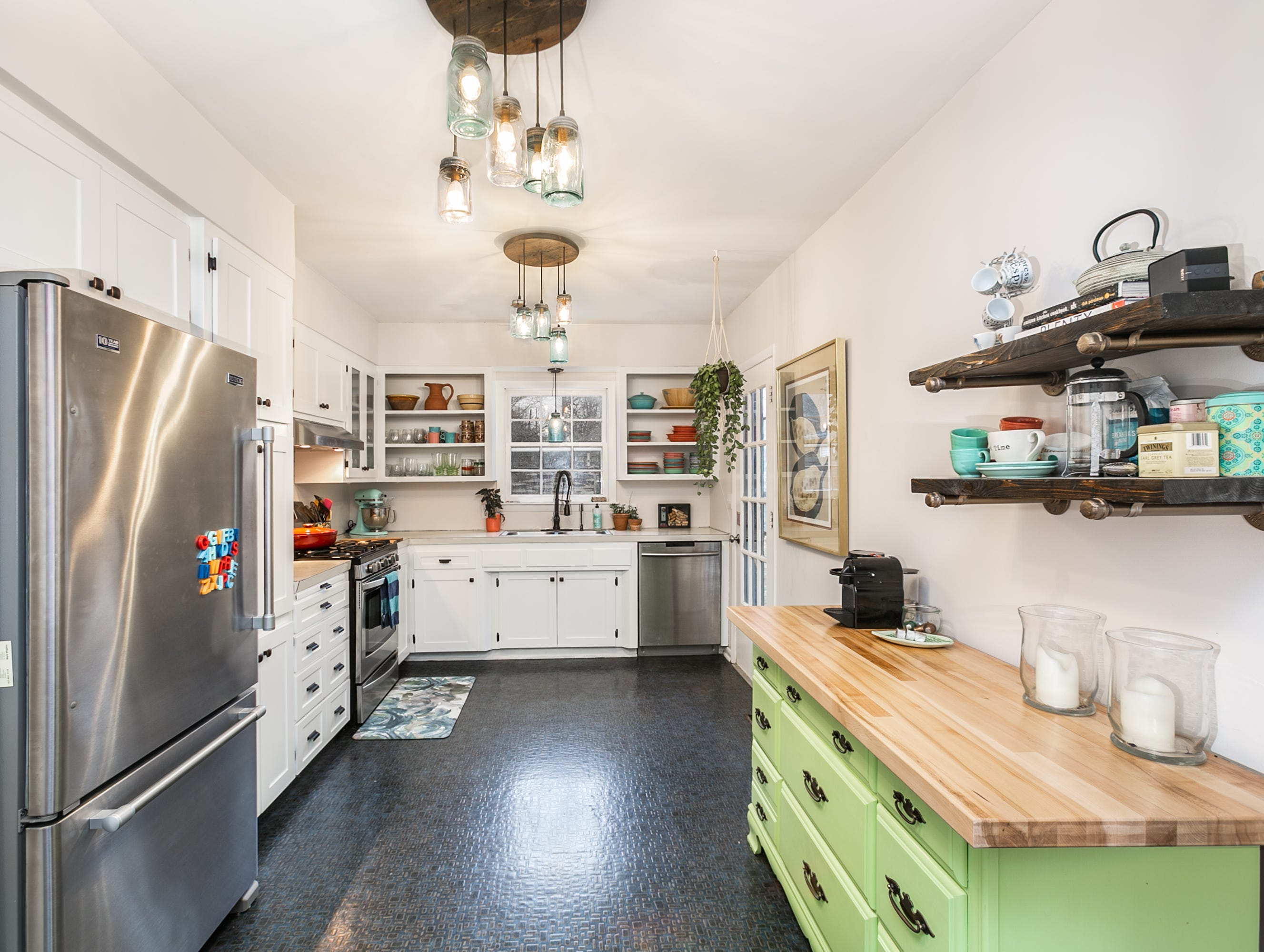 "Adie says she was surprised by the size of the kitchen when she first toured the house. A previous owner had built an 8-foot extension, which made a world of difference. ""I walked into this kitchen and I was like, oh, yeah,"" she says."