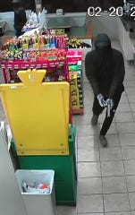 One of two suspects that robbed a Waynesboro convenience store Wednesday night is shown carrying a handgun.