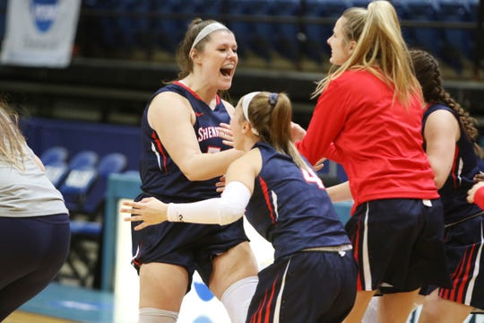 Shenandoah's Jordon Sondrol celebrates with teammates after her team upset the top-seeded Guilford Friday in the ODAC Tournament.