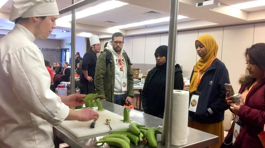 Cody Prasnicki, a student in the culinary program at St. Cloud Technical & Community College, shows high school students how to make banana octopuses at the EPIC event Friday, Feb. 22 at the college.