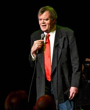 "Garrison Keillor smiles while performing ""Old Friends"" Thursday, Feb. 21, at Pioneer Place on Fifth in St. Cloud."