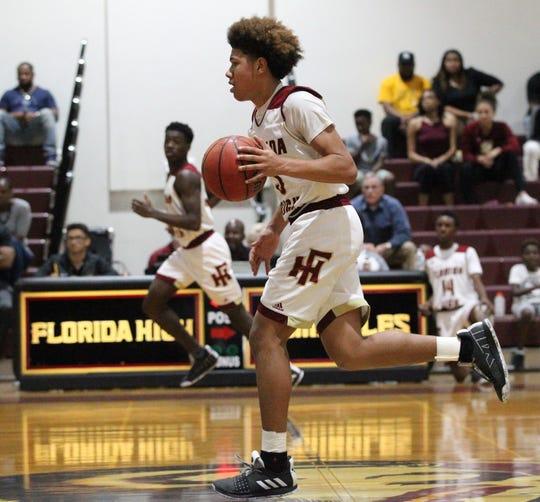 Florida High freshman Tre' Donaldson dribbles up court as the Seminoles beat Pensacola Catholic 47-42 during a Region 1-5A quarterfinal on Feb. 21, 2019.