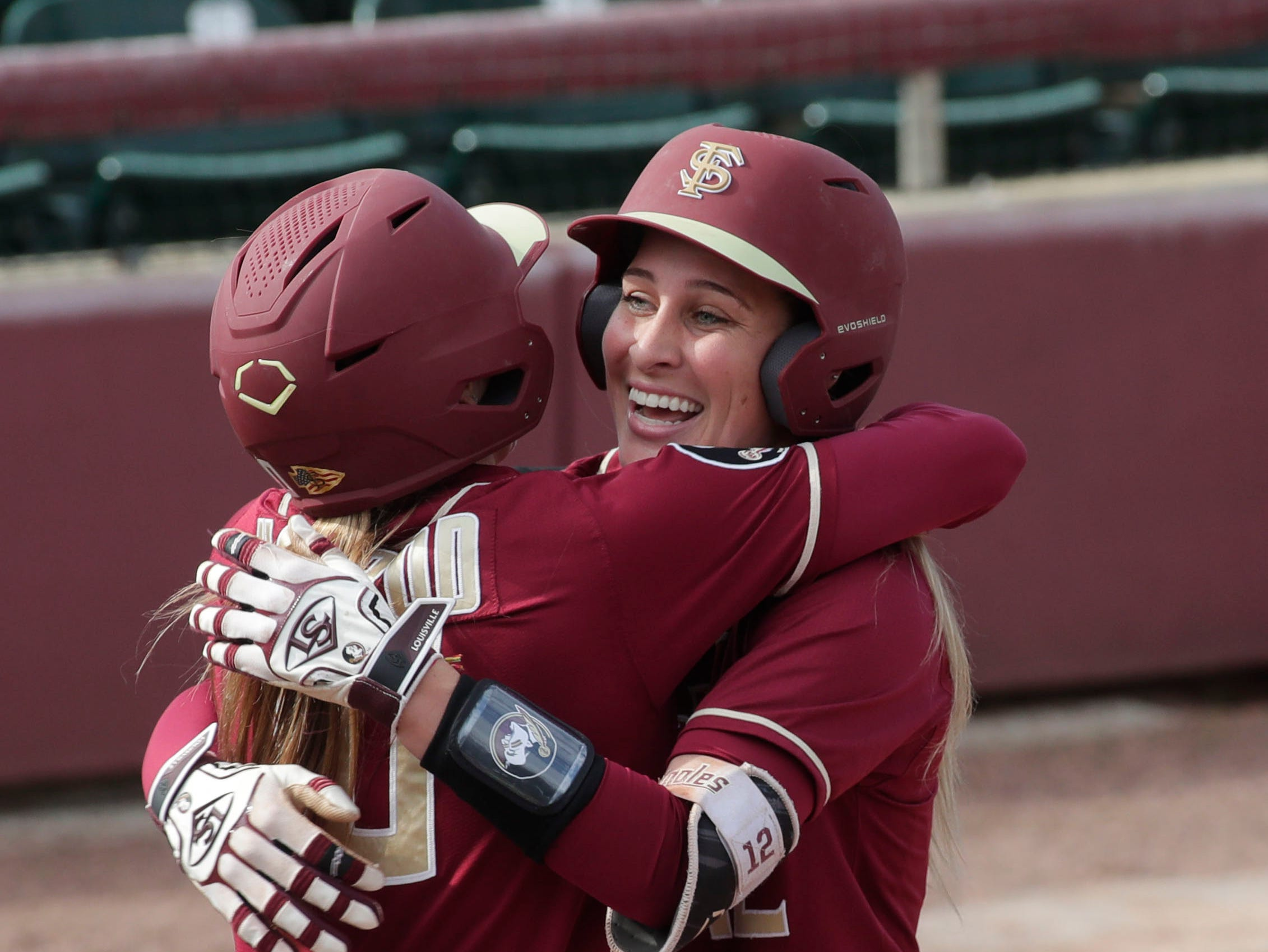 Florida State Seminoles infielder Carsyn Gordon (12) hugs her teammate after hitting a home run. The Florida State Seminoles host the Elon Phoenixes for the Unconquered Tournament, Friday Feb. 22, 2019.