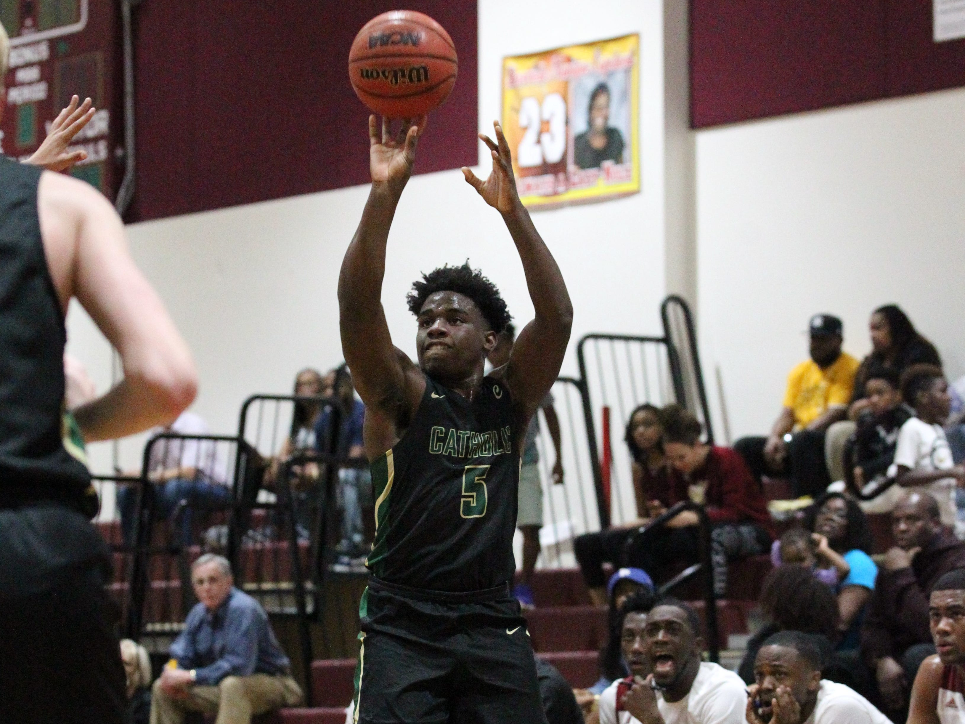 Pensacola Catholic's Ja'kobi Jackson shoots a 3-pointer as the Seminoles beat the Crusaders 47-42 during a Region 1-5A quarterfinal on Feb. 21, 2019.