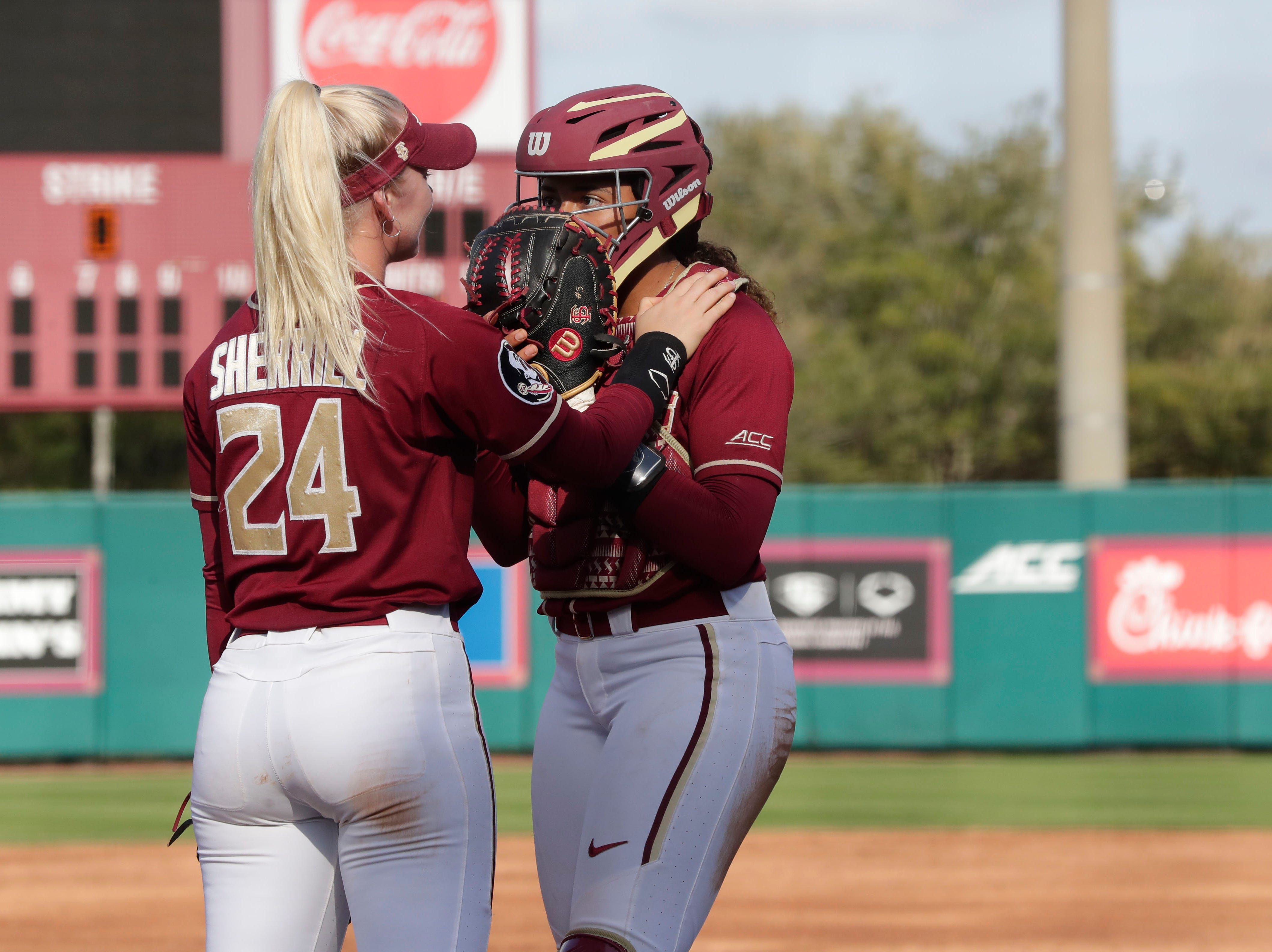 Florida State Seminoles utility player Sydney Sherrill (24) talks with Florida State Seminoles catcher Elizabeth Mason (5). The Florida State Seminoles host the Elon Phoenixes for the Unconquered Tournament, Friday Feb. 22, 2019.