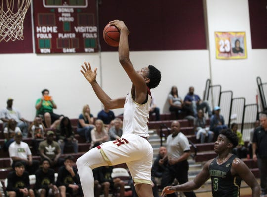 Florida High freshman Jaylen Martin goes up for a fastbreak dunk as the Seminoles beat Pensacola Catholic 47-42 during a Region 1-5A quarterfinal on Feb. 21, 2019.