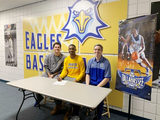 TCC signee El Ellis of Durham, North Carolina put his name on the dotted line  next to assistant coach Ben Mandelbaum (left) and interim head coach Zach Settembre.