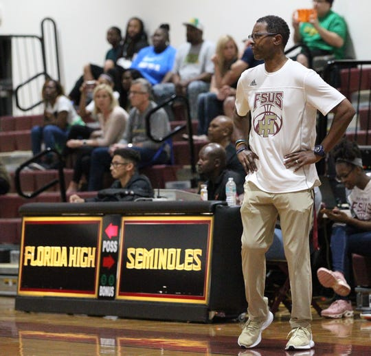 Florida High boys basketball coach Charlie Ward watches as the Seminoles beat Pensacola Catholic 47-42 during a Region 1-5A quarterfinal on Feb. 21, 2019.
