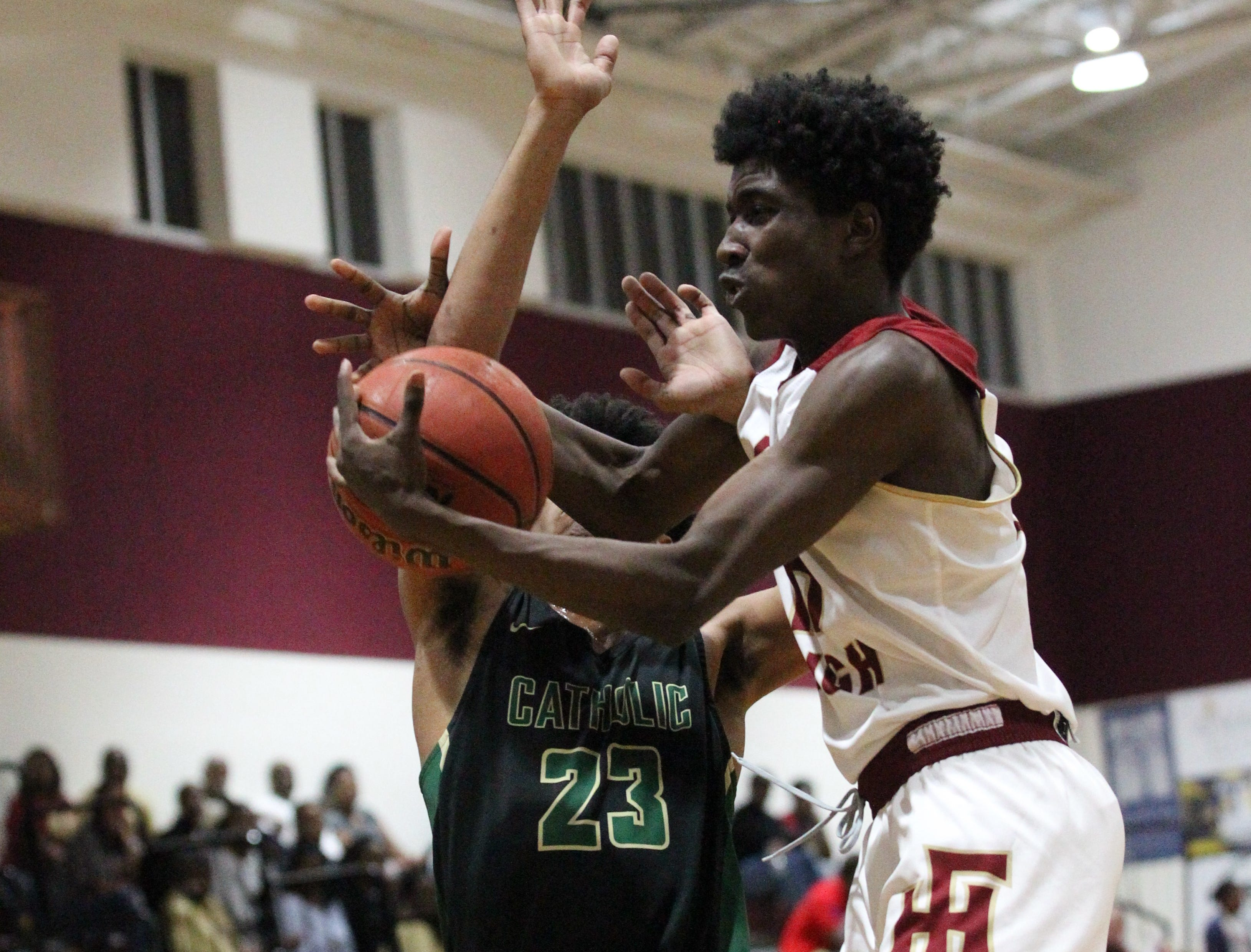 Florida High senior Myles Hopkins grabs a rebound before Pensacola Catholic's Nitrell Bledsoe as the Seminoles beat the Crusaders 47-42 during a Region 1-5A quarterfinal on Feb. 21, 2019.