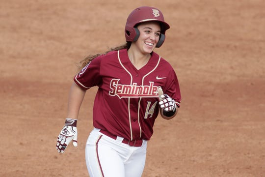 Florida State Seminoles utility player Savannah Parker smiles as she rounds the bases after hitting a home run. The Seminoles faced Elon for the Unconquered Tournament, Friday Feb. 22, 2019.