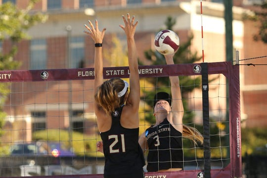 FSU's Molly McBain (21) and Sara Putt (3) are two of the Seminoles' returning players that had 28-plus wins last season.