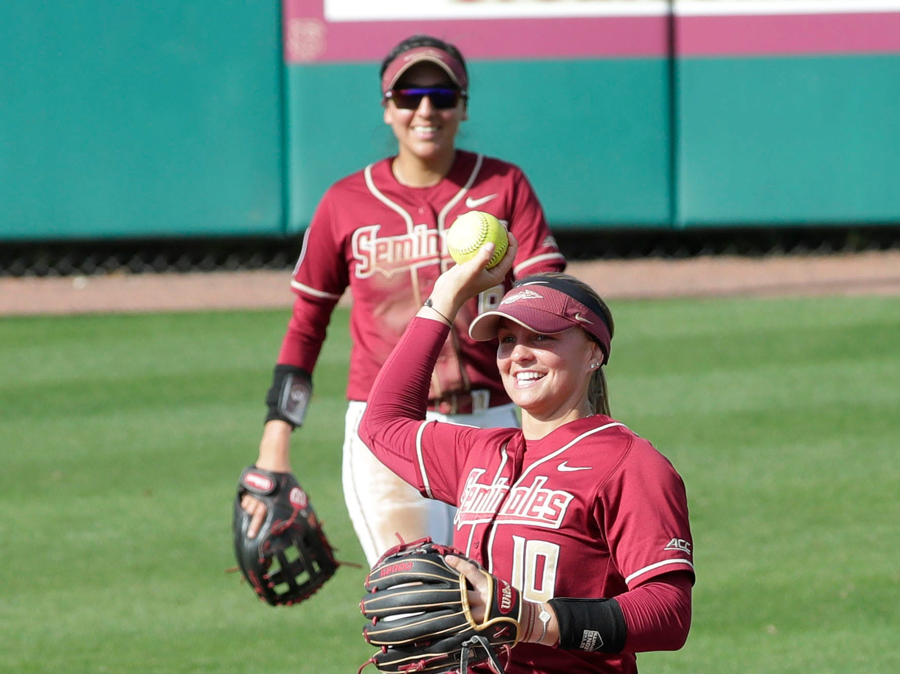 Florida State Seminoles infielder Cali Harrod (10) throws the ball to the pitcher. The Florida State Seminoles host the Elon Phoenixes for the Unconquered Tournament, Friday Feb. 22, 2019.