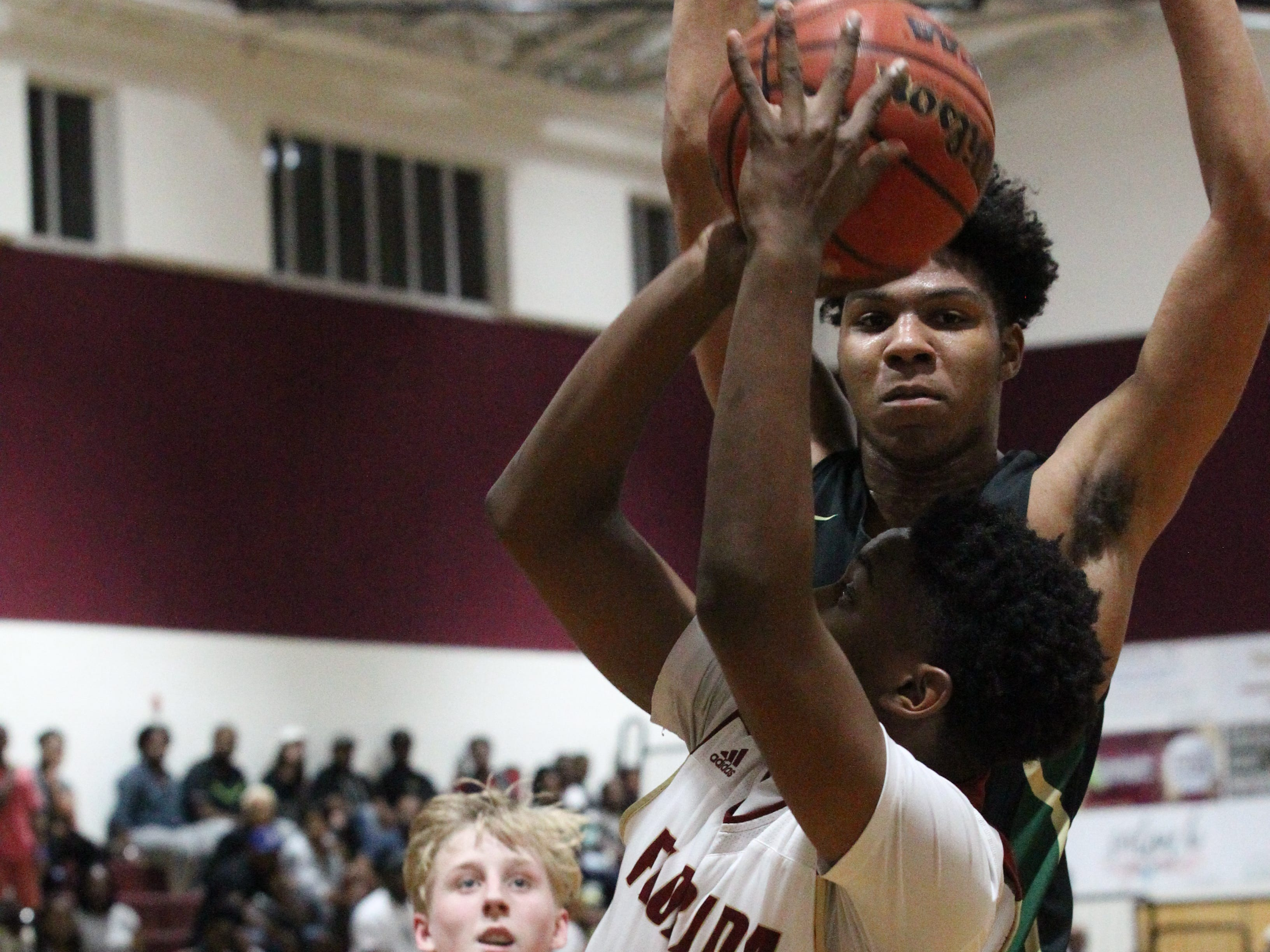 Florida High freshman Kent Carroll drives baseline for a basket as the Seminoles beat Pensacola Catholic 47-42 during a Region 1-5A quarterfinal on Feb. 21, 2019.