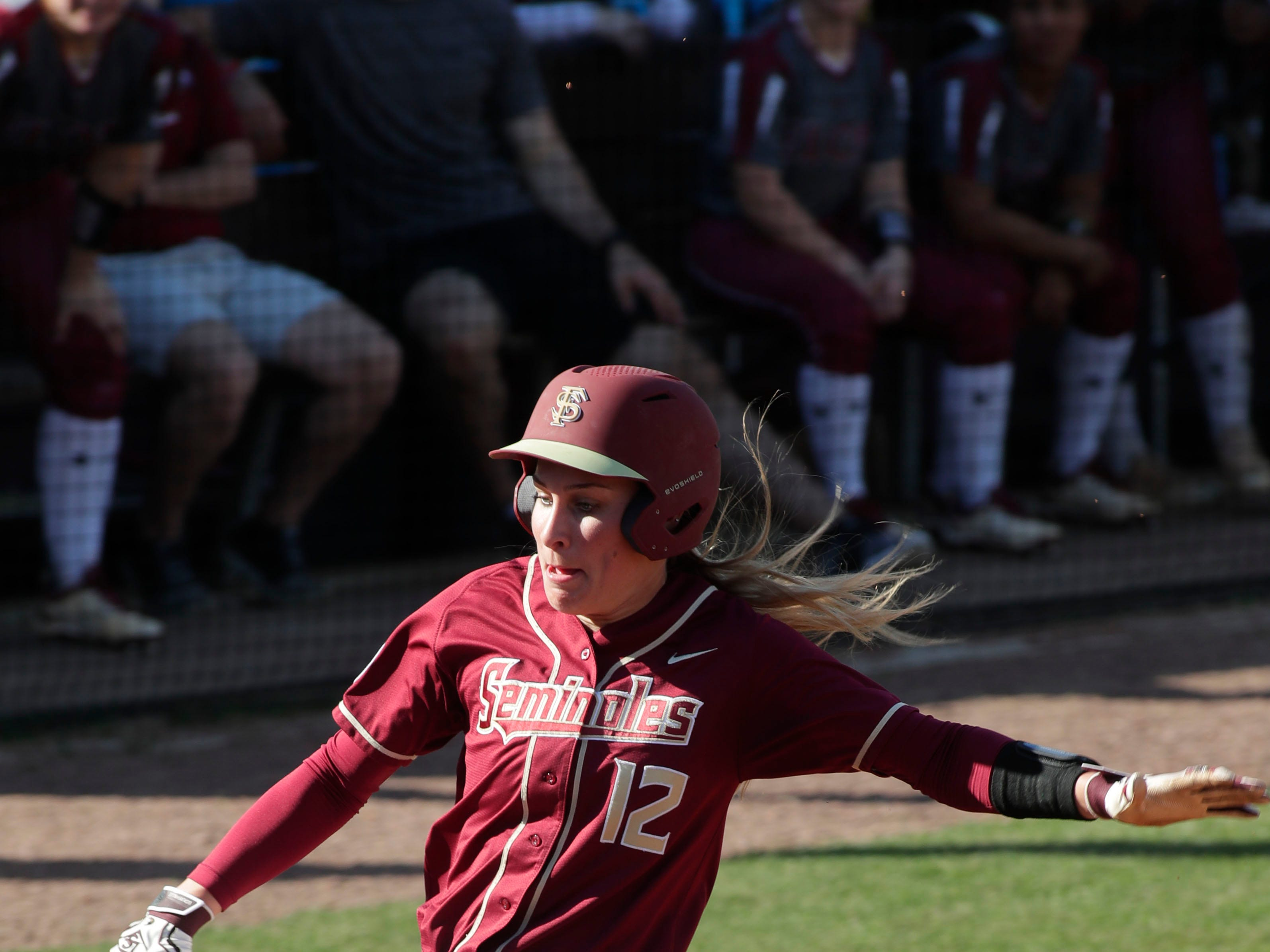 Florida State Seminoles infielder Carsyn Gordon (12) slides into home plate to score a run. The Florida State Seminoles host the Elon Phoenixes for the Unconquered Tournament, Friday Feb. 22, 2019.