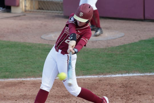 Florida State Seminoles utility player Sydney Sherrill (24) makes contact on her swing. The Florida State Seminoles host the Elon Phoenixes for the Unconquered Tournament, Friday Feb. 22, 2019.