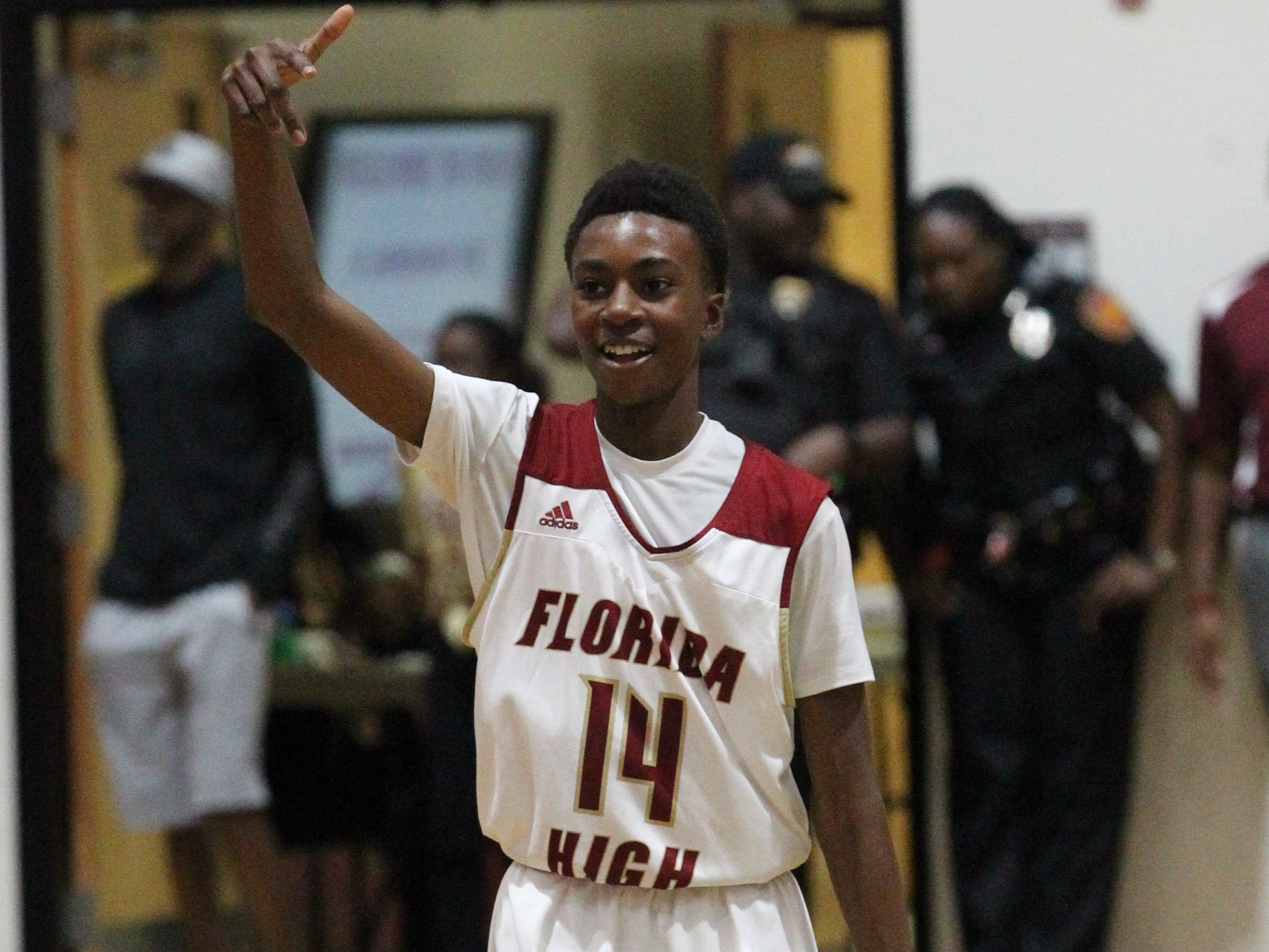 Florida High eighth-grader Anthony Robinson signals after a made 3-pointer as the Seminoles beat Pensacola Catholic 47-42 during a Region 1-5A quarterfinal on Feb. 21, 2019.