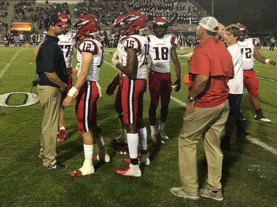 Josh Watkins (far left), shown here in St. Lucie West Centennial's Region 2-8A quarterfinal at Dr. Phillips on Nov. 9, was named the school's new head coach on Friday.