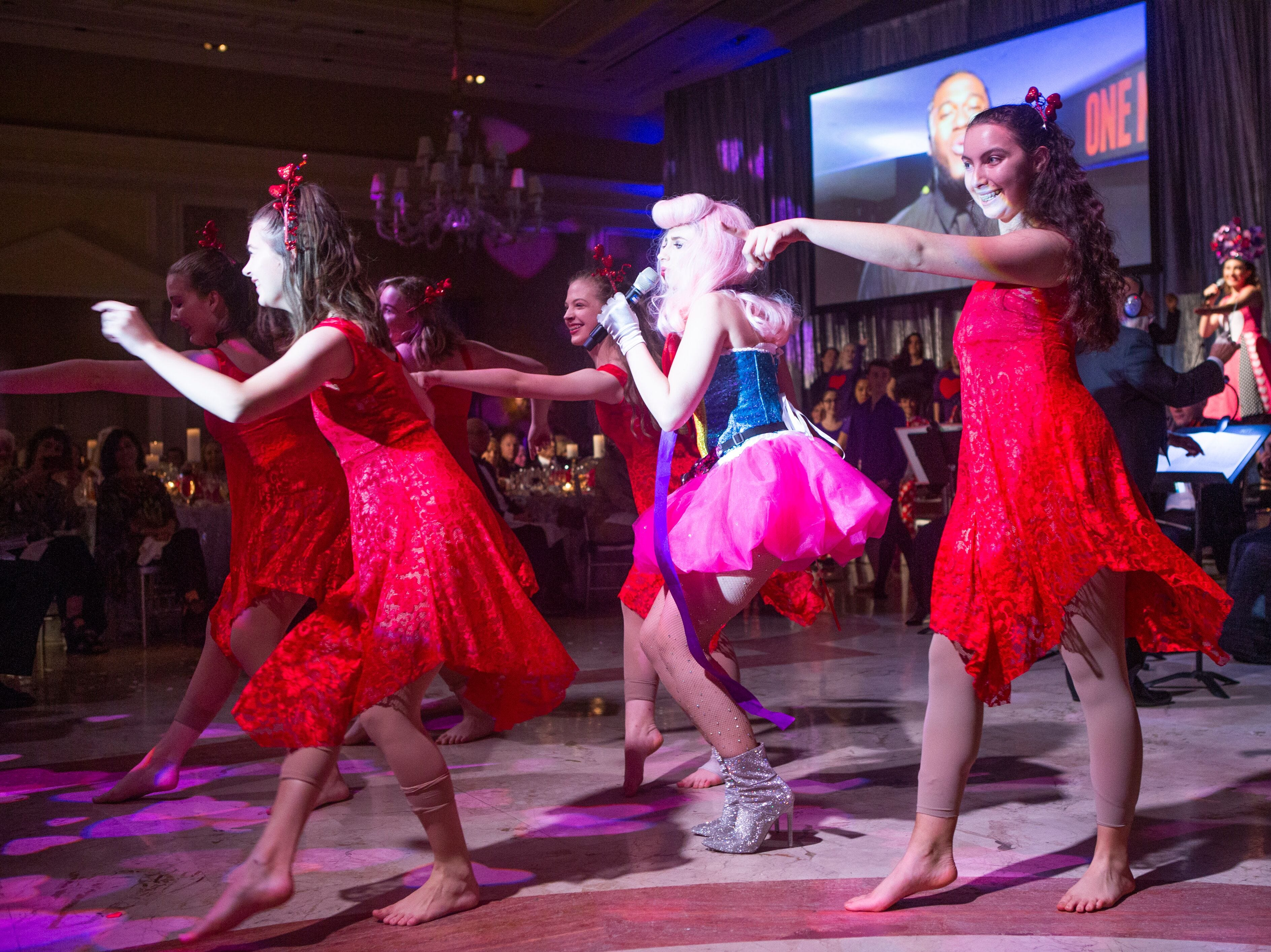 """The Disco Ball"" featured high-energy performances by more than 100 youth performers, including Alina Pimentel, front left, Goldner Conservatory graduate Emily Rynasko, center, and Aviva Senzon, front right, at The Breakers Palm Beach."