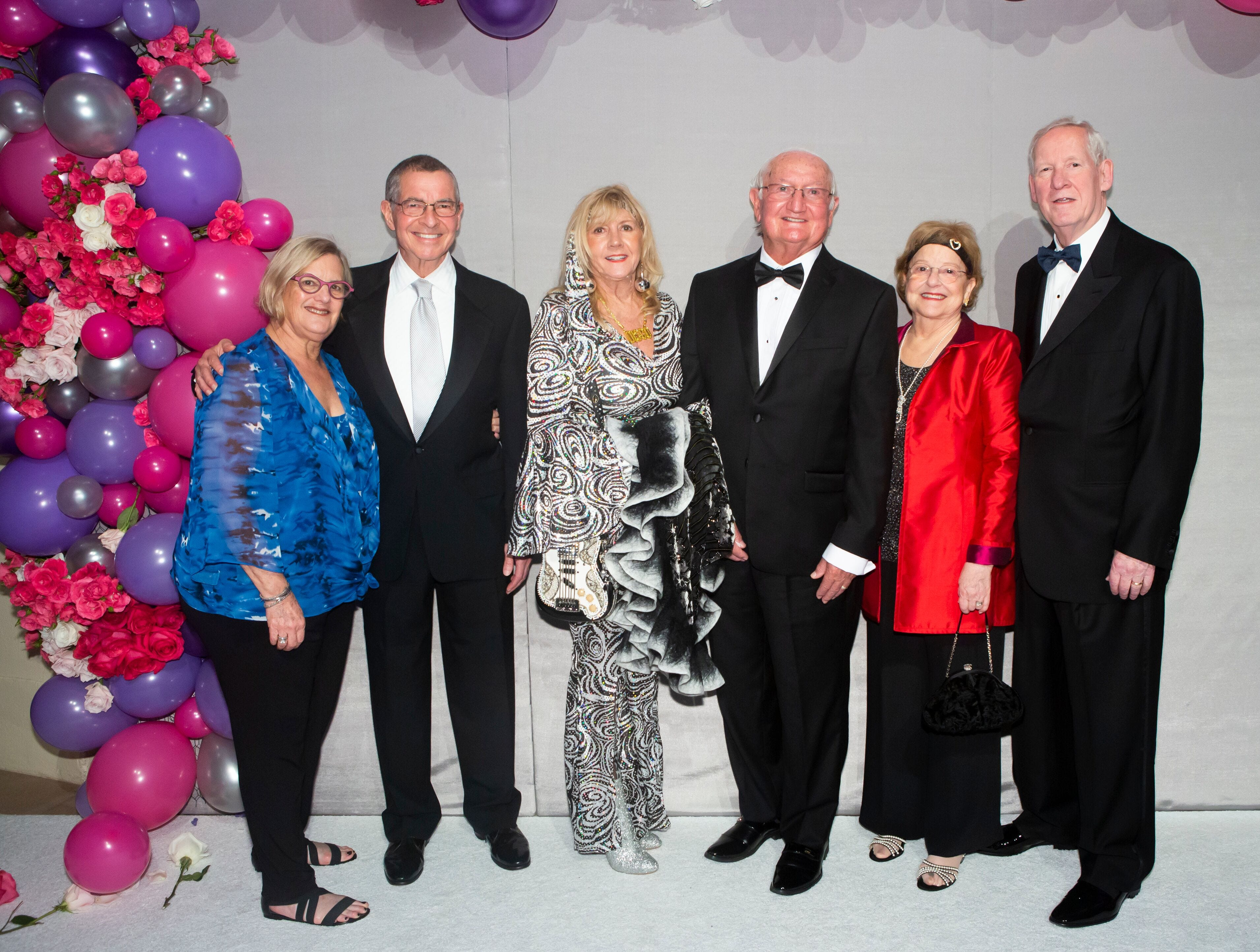 """Holly and Alexander Bondar, left, Deena and Stuart Lockman and Martie and Bob Sachs at """"The Disco Ball"""" Feb.2at The Breakers Palm Beach."""