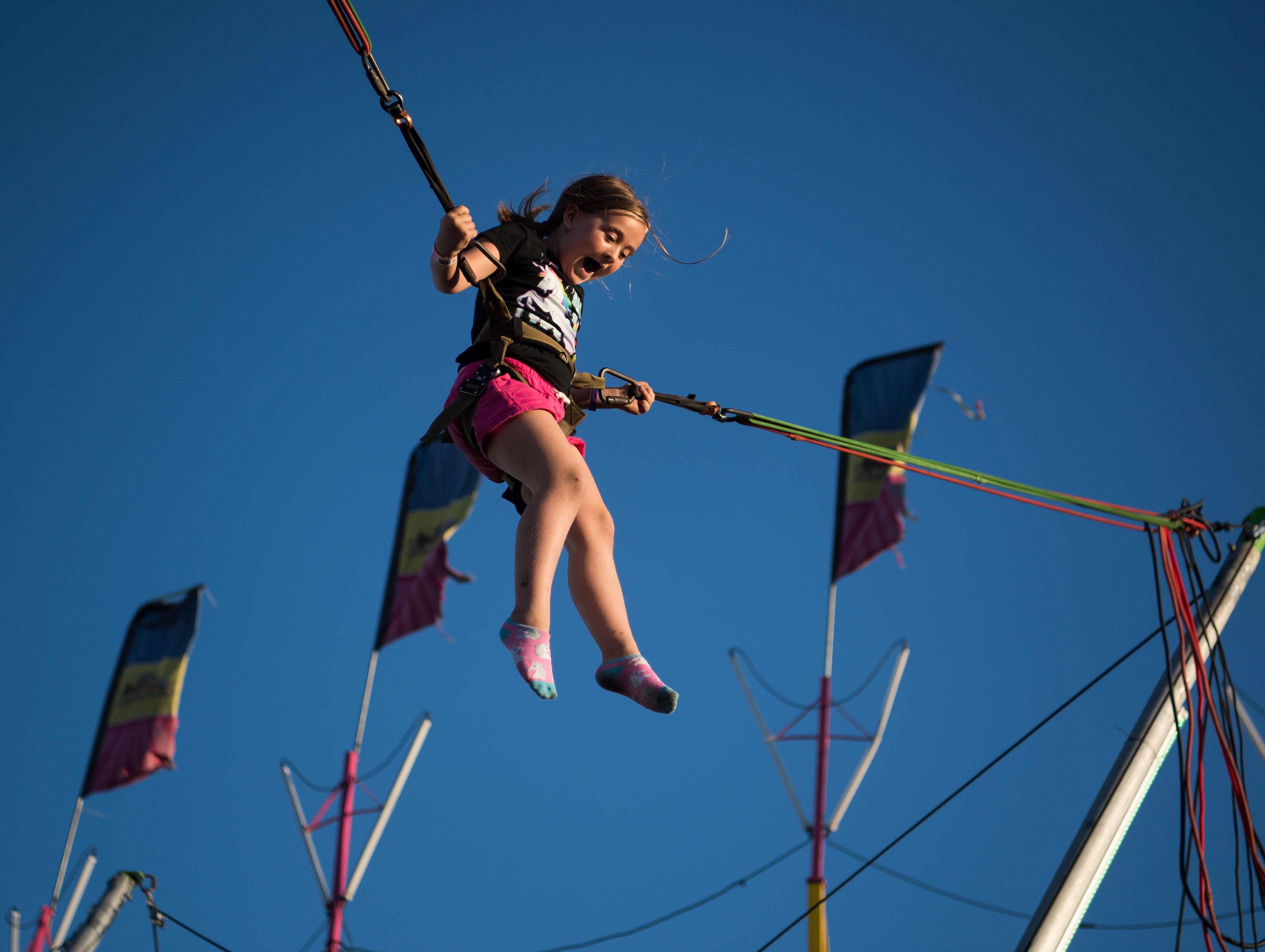 """Ashlynn Mickler, 6, of Live Oak, enjoys the Euro Bungee activity at the 54th annual St. Lucie County Fair on opening night Friday, Feb. 22, 2019, at the St. Lucie County Fairgrounds in Fort Pierce. """"She did it at the Live Oak fair last year, and fell in love with it,"""" said Ashlynn's grandmother, Jo Ross, of St. Lucie County. """"She wants to be able to jump out of airplanes like I used to when I was younger,"""" Ross added. For more information on the fair, which runs through March 3, go to www.stluciecountyfair.org."""