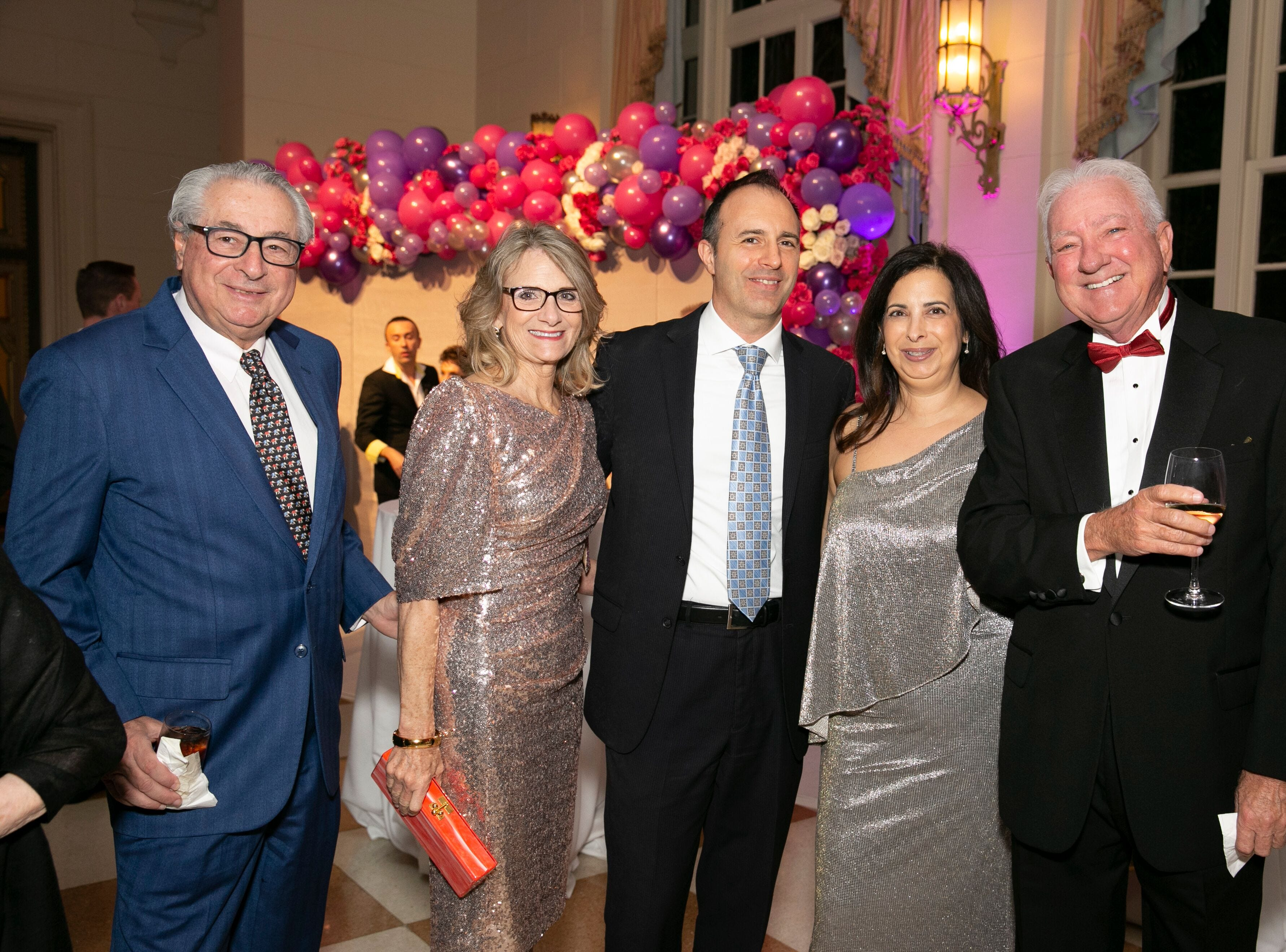 """Carl and Sharon Domino, left, with Maria and Victoria Bertuzzelli  at """"The Disco Ball"""" Feb.2at The Breakers Palm Beach."""