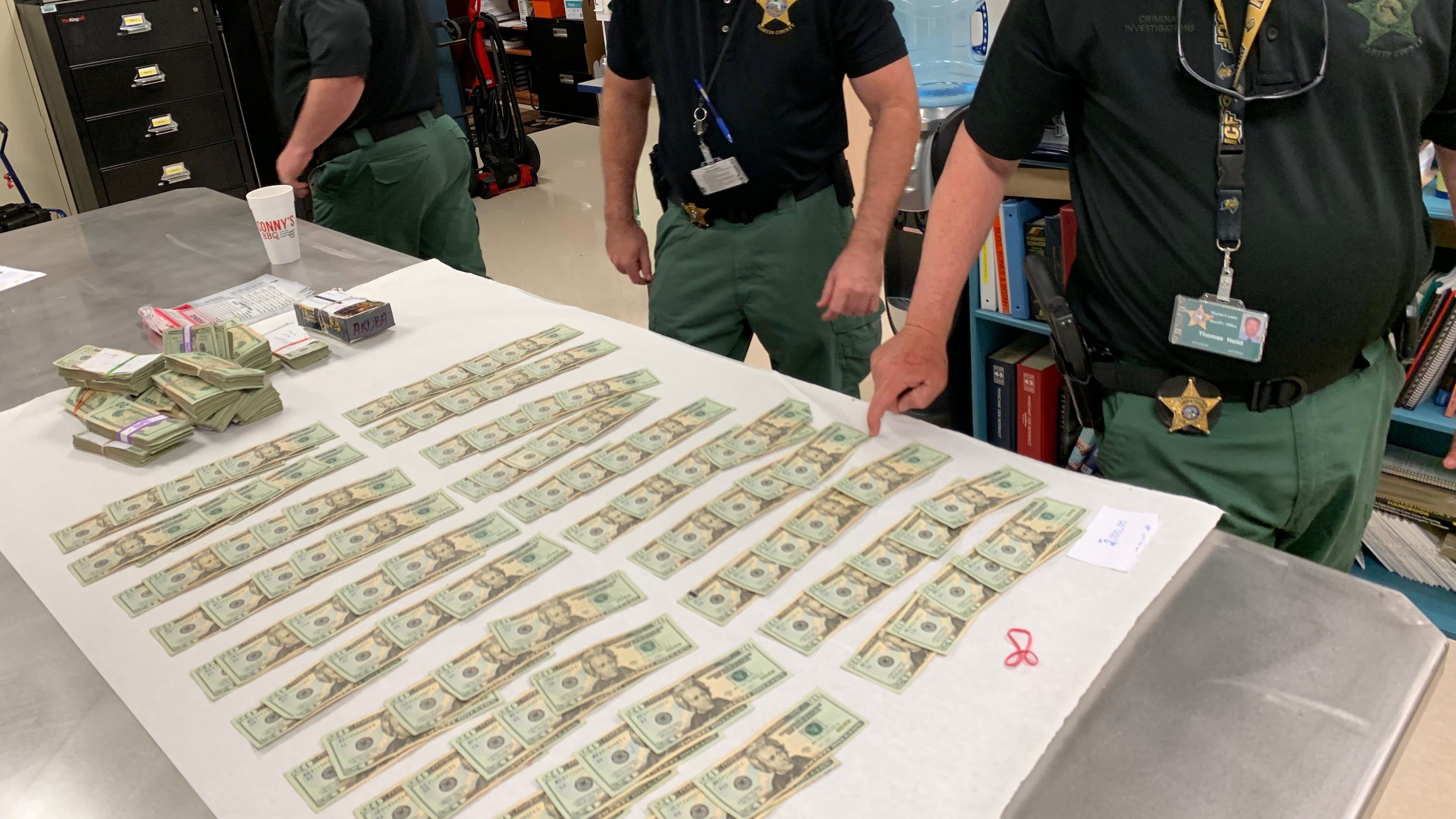 Thousands of dollars seized in an investigation into illicit spas are seen in this photo provided by the Martin County Sheriff's Office.