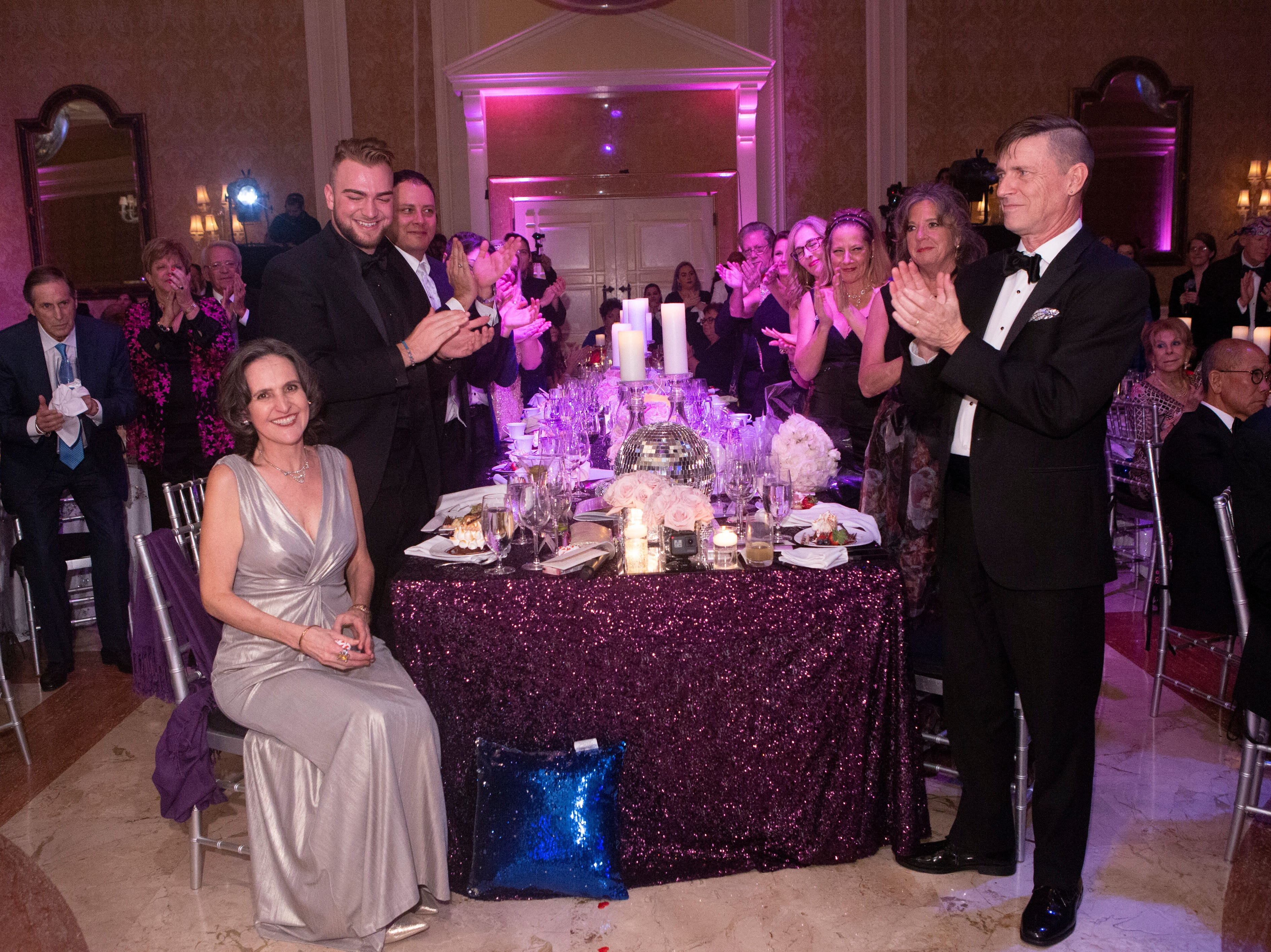 "Honorees Julie Rowe, seated, and the faculty of the Goldner Conservatory of Performing Arts at the Maltz Jupiter Theatre's ""The Disco Ball"" Feb. 2 at The Breakers Palm Beach."
