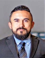 John Mimbela Jr., co-owner of Marco's Pizza franchise in El Paso.