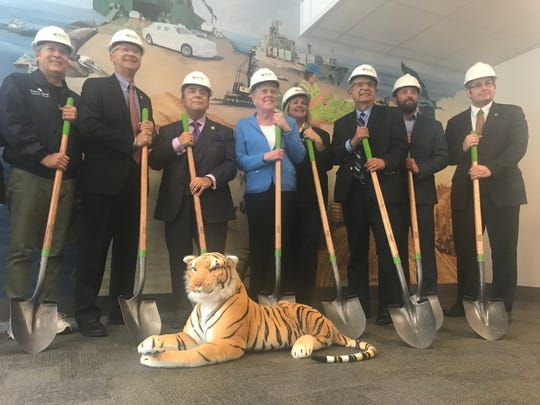 Congresswoman Julia Brownley, center, poses with other officials during a groundbreaking ceremony Thursday for the deepening project at the Port of Hueneme. The ceremony was held indoors due to the threat of rain.