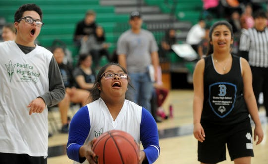 Jazmin Ramirez, of Pacifica High School in Oxnard, shoots the ball in a game against Buena High School. Ramirez is a member of the Unified Sports Champions teams, a Special Olympics program.