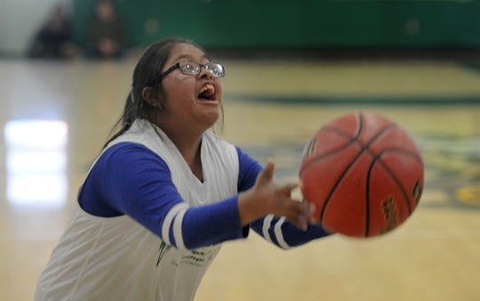 Jazmin Ramirez, of Pacifica High School in Oxnard, shoots the ball in a game against Buena High School. Ramirez is part of Pacifica's Unified Sports Champions teams, a Special Olympics program. The teams are comprised of both special education and general education students.