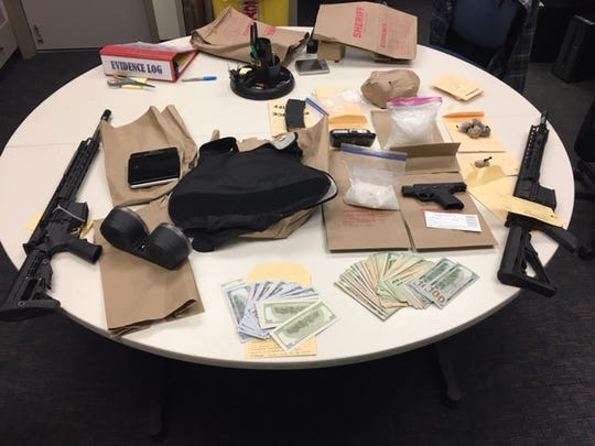 A team from the Ventura County Sheriff's Office seized drugs, weapons, ammunition and cash during an arrest in Granada Hills Wednesday.